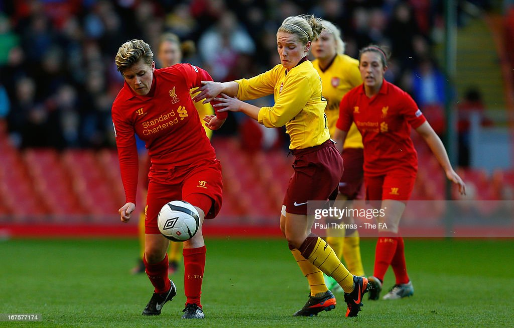 Katrin Omarsdottir (L) of Liverpool in action with Kim Little of Arsenal during the Womens FA Cup Semi Final match between Liverpool Ladies FC and Arsenal Ladies FC at Anfield on April 26, 2013 in Liverpool, England.