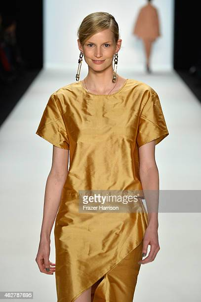 Katrin Thormann walks the runway at the Malaikaraiss Show during MercedesBenz Fashion Week Autumn/Winter 2014/15 at Brandenburg Gate on January 15...