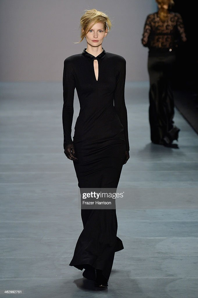 <a gi-track='captionPersonalityLinkClicked' href=/galleries/search?phrase=Katrin+Thormann&family=editorial&specificpeople=5625214 ng-click='$event.stopPropagation()'>Katrin Thormann</a> walks the runway at the Marc Cain show during Mercedes-Benz Fashion Week Autumn/Winter 2014/15 at Brandenburg Gate on January 16, 2014 in Berlin, Germany.