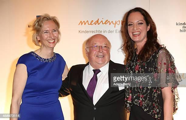 Katrin Wiedemann Norbert Bluem and Natalia Woerner arrive for the 16th Medienpreis der Kindernothilfe award ceremony on November 14 2014 in Berlin...