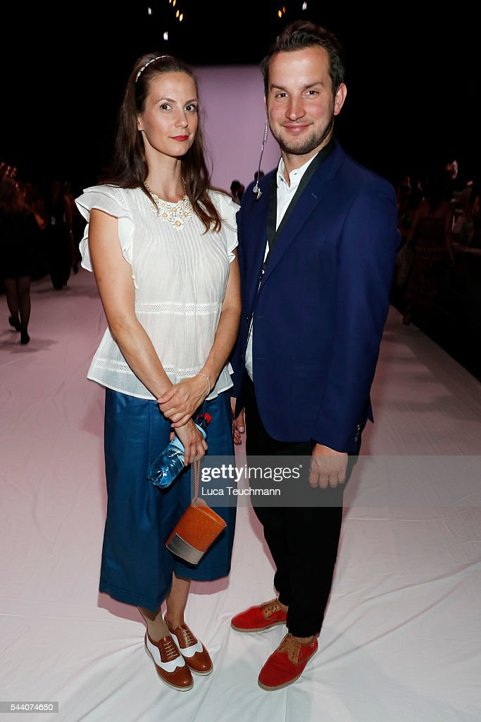 Katrin Wrobel and Fabian Winkelsesser attend the Julian Zigerli show during the Mercedes-Benz Fashion Week Berlin Spring/Summer 2017 at Erika Hess Eisstadion on July 1, 2016 in Berlin, Germany.