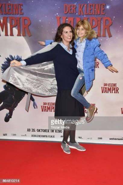 Katrin Wrobel and her daughter Louisa attend the 'Der kleine Vampir' premiere on October 21 2017 in Berlin Germany