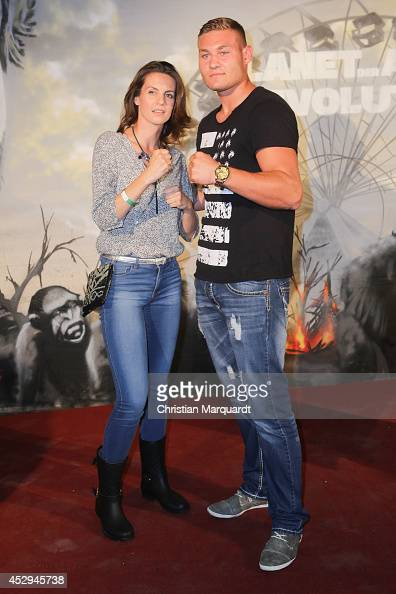 Katrin Wrobel and Tom Schwarz attend a special preview for the film 'Dawn of the Planet of the Apes' at Freizeitpark Spreepark on July 30 2014 in...