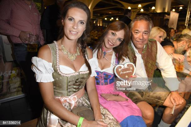 Katrin Wrobel Jean Bork and Charles Rettinghaus during the Angermaier TrachtenNacht at Hofbraeuhaus on August 31 2017 in Berlin Germany