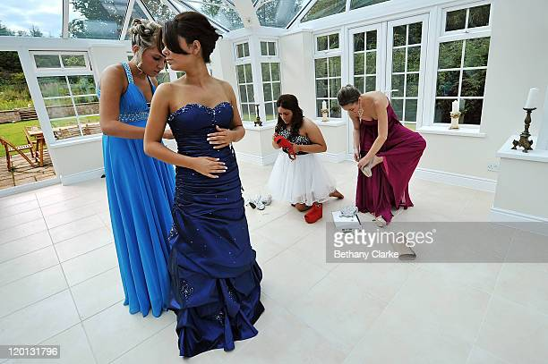 Katrina Cooper is helped by Jessica Rutherford to put on her dress before the school prom on July 1 2011 in Newcastle United Kingdom After months of...