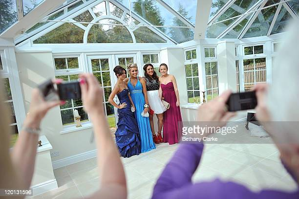 Katrina Cooper Jessica Rutherford Lorella Mango Erin Bowmaker post for family members to take pictures before the school prom on July 1 2011 in...