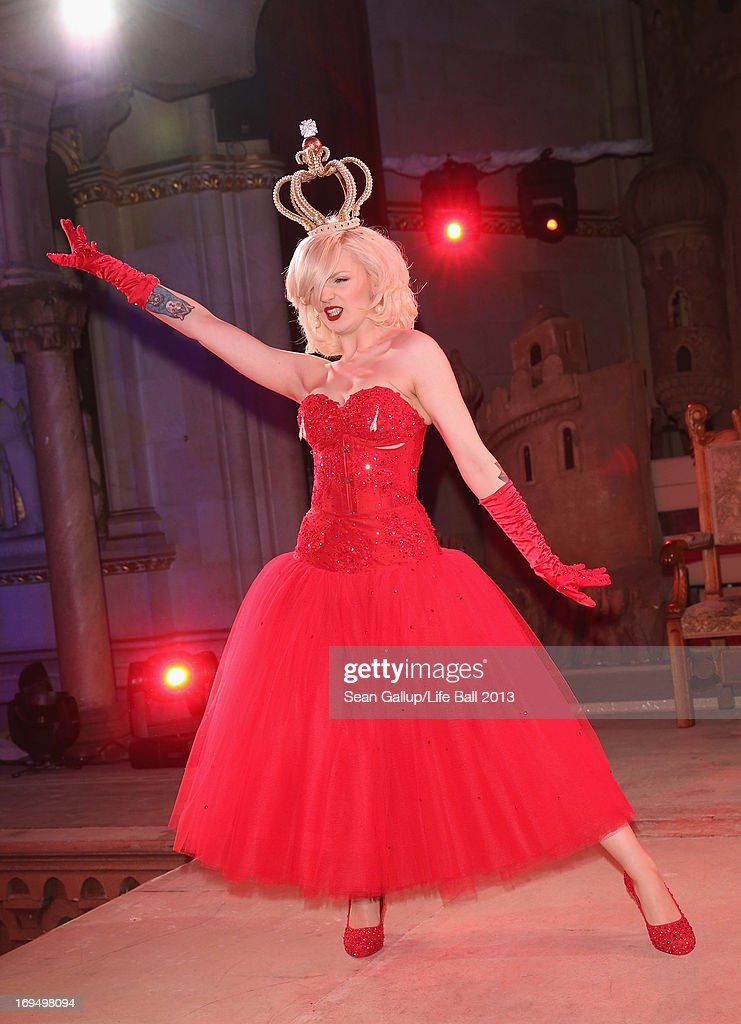 Katrina Darling, who is a distant cousin of Kate Middleton and a burlesque dancer, performs a striptease at the after show party at the 2013 Life Ball in city hall on May 25, 2013 in Vienna, Austria.