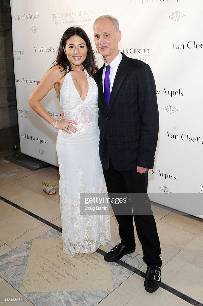 Katrina Eugenia and filmmaker <a gi-track='captionPersonalityLinkClicked' href=/galleries/search?phrase=John+Waters+-+Director&family=editorial&specificpeople=209202 ng-click='$event.stopPropagation()'>John Waters</a> attend the Norman Mailer Center's Fifth Annual Benefit Gala sponsored by Van Cleef & Arpels on October 17, 2013 in New York City.