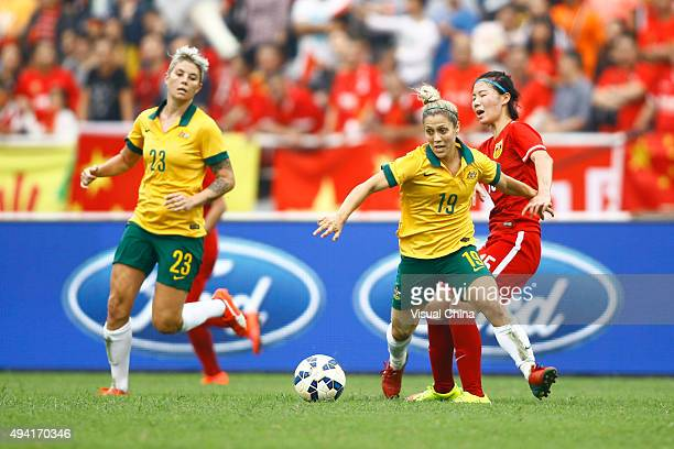 Katrina Gorry of Australia drives the ball in the match between China and Australia during the 2015 Yongchuan Women's Football International Matches...