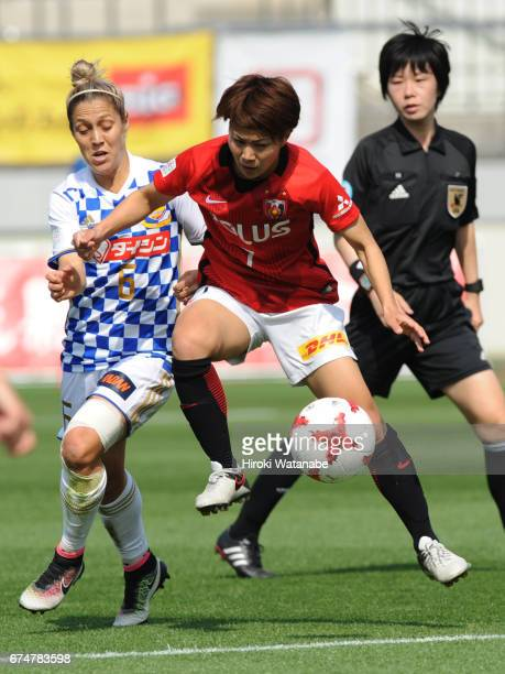 Katrina Gorry of Mynavi Vegalta Sendai Ladies and Risa Ikadai of Urawa Red Diamonds Ladies compete for the ball during the Nadeshiko League match...