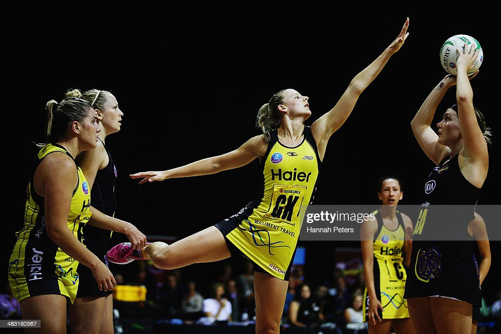Katrina Grant of the Pulse defends against Ellen Halpenny of the Magic during the ANZ Championship match between the Magic and the Pulse on April 7, 2014 in Auckland, New Zealand.
