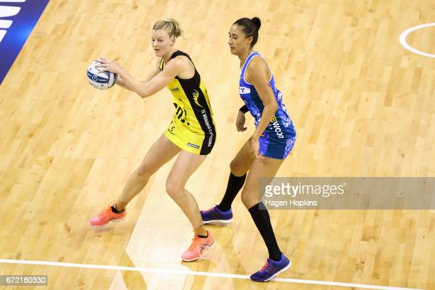 Katrina Grant of the Pulse receives a pass undre pressure from Maria Tutaia of the Mystics during the New Zealand Premiership match between the Pulse...