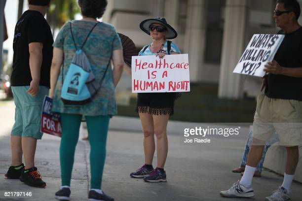 Katrina Greenwood joins with other protesters against Republican senators who have not spoken up against Affordable Care Act repeal and demand...