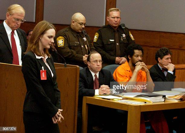 Katrina Hannum daughter of sniper victim Linda Franklin passes in front of the defense table where convicted sniper John Allen Muhammad and his...