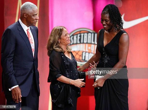 Katrina McClain is greeted by presenters Hall of Fame player Julius Erving and Hall of Fame coach C Vivian Stringer after her speech during the...
