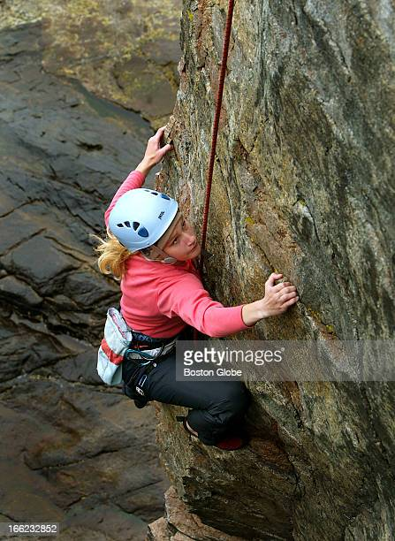 Katrina Schweikert climbs on Otter Cliffs at Acadia National Park on Mount Desert Island overlooking the Atlantic Ocean with the aid of Alden Strong...