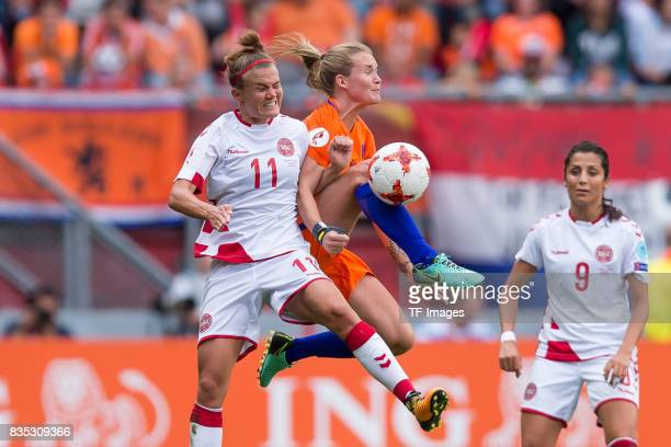 Katrine Veje of Denmark and Desiree van Lunteren of the Netherlands battle for the ball during the UEFA Women's Euro 2017 final match between Denmark...