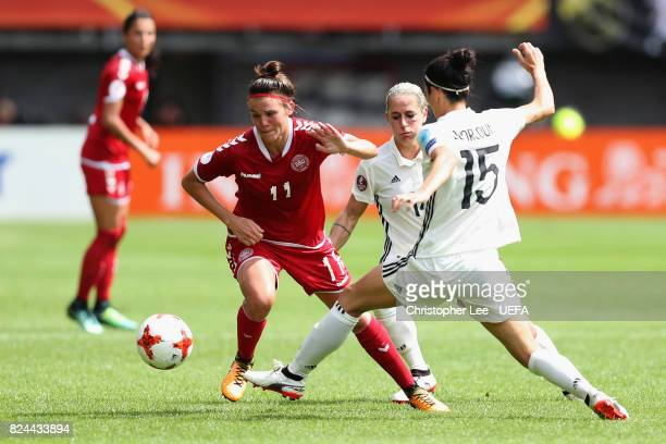 Katrine Veje of Denmark attempts to get past Sara DoorsounKhajeh of Germany during the UEFA Women's Euro 2017 Quarter Final match between Germany and...