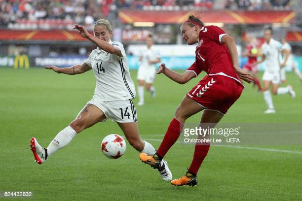 Katrine Veje of Denmark clears the ball while under pressure from Anna Blasse of Germany during the UEFA Women's Euro 2017 Quarter Final match...