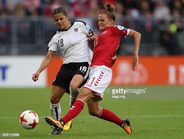 Katrine Veje of Denmark passes under pressure from Laura Feiersinger of Austria during the UEFA Women's Euro 2017 Semi Final match between Denmark...