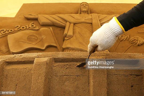 Katsuhiko Chaen sand sculptor and Executive Director of the Sand Museum works on a Sand sculpture of the famous Christ the Redeemer statue of Jesus...