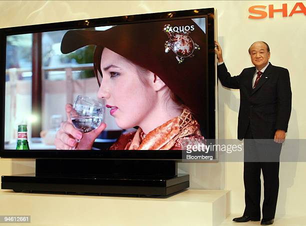 Katsuhiko Machida president of Sharp Corp poses with an 108inch liquid crystal display television the largest in the world at a news conference in...
