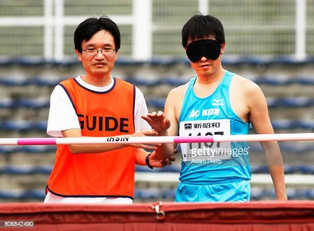 Katsuhisa Uchida of Japan prepares to compete in Men's High Jump T11 Final during the photo seminar at the Kanto Para Athletics Championships at...