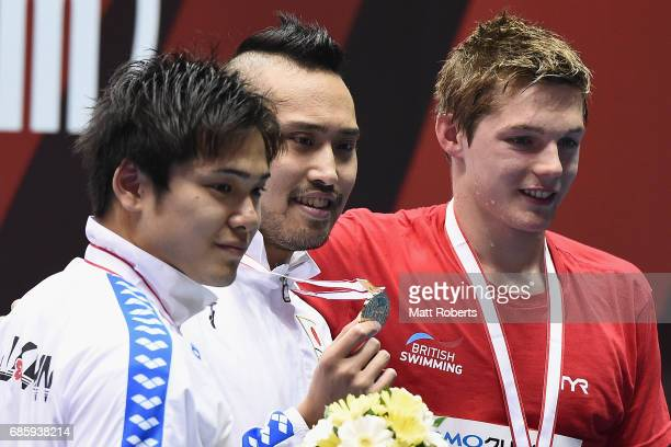 Katsumi Nakamura of Japan Shiri Shioura of Japan and Duncan Scott of Great Britain pose with their medals on the podium after the 100m Freestyle...