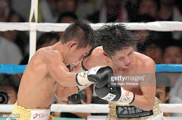 Katsunari Takayama and Riku Kano of Japan exchange punches during the WBO Minimumweight title bout at the Komagatani Gymansium on August 20 2016 in...