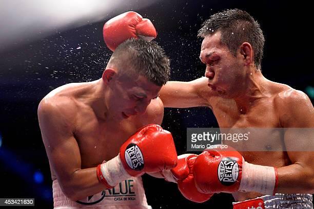 Katsunari Takayama hits Francisco Rodriguez 'El Chihuas' during the IBF/WBO Minimumweight Unification Title fight at Arena Monterrey on August 09...