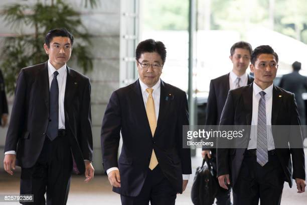 Katsunobu Kato newlyappointed health labor and welfare minster of Japan center arrives at the Prime Minister's official residence in Tokyo Japan on...