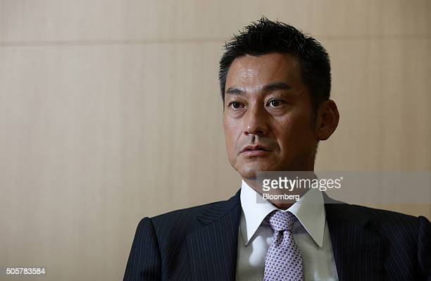 Katsunori Sago executive vice president of Japan Post Bank Co listens during an interview in Tokyo Japan on Wednesday Jan 20 2016 Japan Post Bank on...