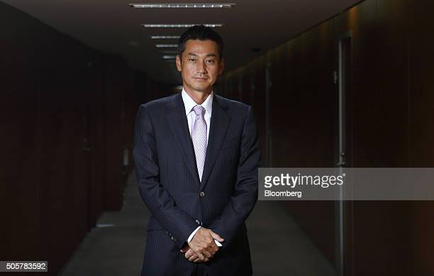 Katsunori Sago executive vice president of Japan Post Bank Co poses for a photograph in Tokyo Japan on Wednesday Jan 20 2016 Japan Post Bank on the...