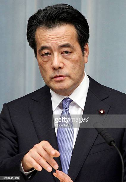 Katsuya Okada Japan's newlynamed deputy prime minister gestures during a news conference at the prime minister's official residence in Tokyo Japan on...