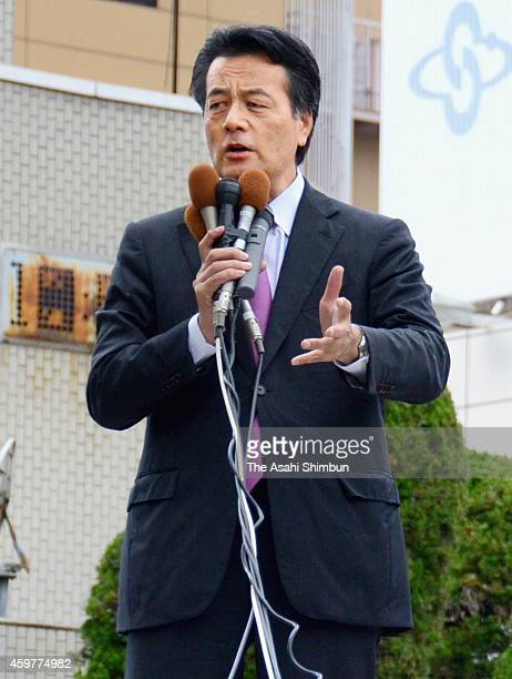 Katsuya Okada of Democratic Party of Japan makes a street speech on November 29 2014 in Tokushima Japan The lower house election campaign is...