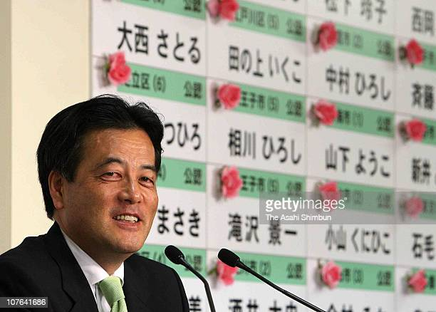 Katsuya Okada secretary general of the Democratic Party of Japan speaks during a press conference at their headquarters on July 12 2009 in Tokyo...