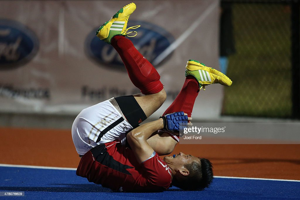 Katsuyoshi Nagasawa of Japan holds his leg after being hit by the ball during the Test Match between the New Zealand Black Sticks and Japan at Blake Park on March 12, 2014 in Mount Maunganui, New Zealand.