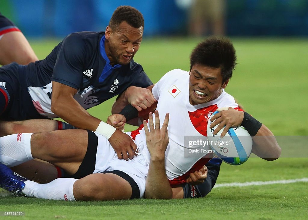 Katsuyuki Sakai of Japan scores a try during the Men's Rugby Sevens Pool C match between Great Britain and Japan on Day 4 of the Rio 2016 Olympic...