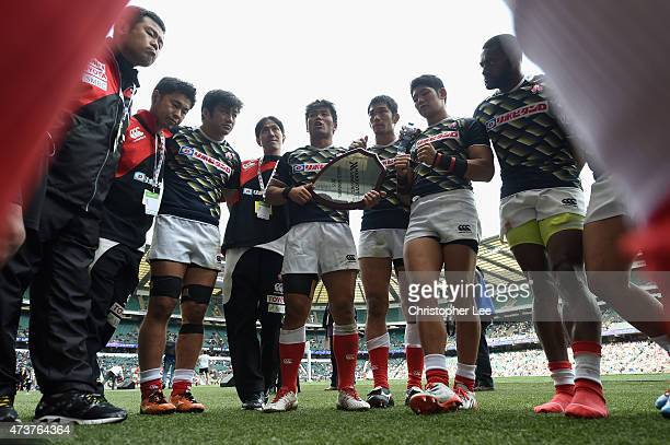 Katsuyuki Sakai of Japan talks to his team mates as he holds the Shield as they celebrate winning the Shield Final match between Japan and France in...