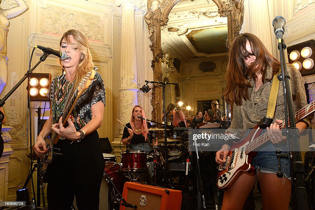 Katty Besnard, Anais Vandevyvere and Louise Basilien from The Plastiscines perform during the the Plastiscines private concert hosted by MTV Pulse at The Carmen Club on October 9, 2013 in Paris, France.