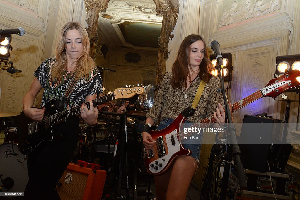 Katty Besnard and Louise Basilien from The Plastiscines perform during the the Plastiscines private concert hosted by MTV Pulse at The Carmen Club on October 9, 2013 in Paris, France.