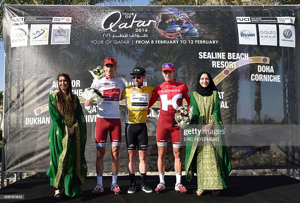 Katusha Team leader Alexander Kristoff (2R), Dimension Data team leader Britain's Mark Cavendish (C) and Katusha Viacheslav Kuznetsov (2L) pose on the podium after finishing first, second and best young rider during the second stage of the 2016 Tour of Qatar cycling race, starting and finishing at the Qatar University on February 9, 2016. / AFP / ERIC FEFERBERG
