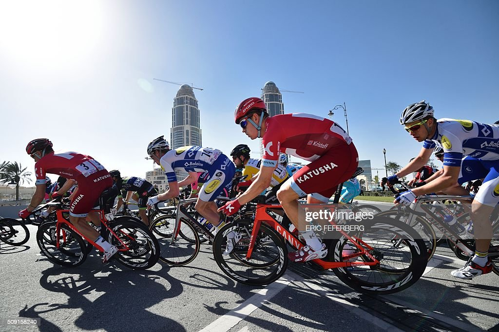 Katusha team leader Norvegian Alexander Kristoff (2R) and Dimension Data Britain's Mark Cavendish (back) ride in the pack in the Pearl Corniche district in Doha during the second stage of the 2016 Tour of Qatar cycling race, starting and finishing at the Qatar University on February 9, 2016. Norway's Alexander Kristoff won a sprint finish ahead of Britain's Marc Cavendish for the second stage of the Tour of Qatar. FEFERBERG