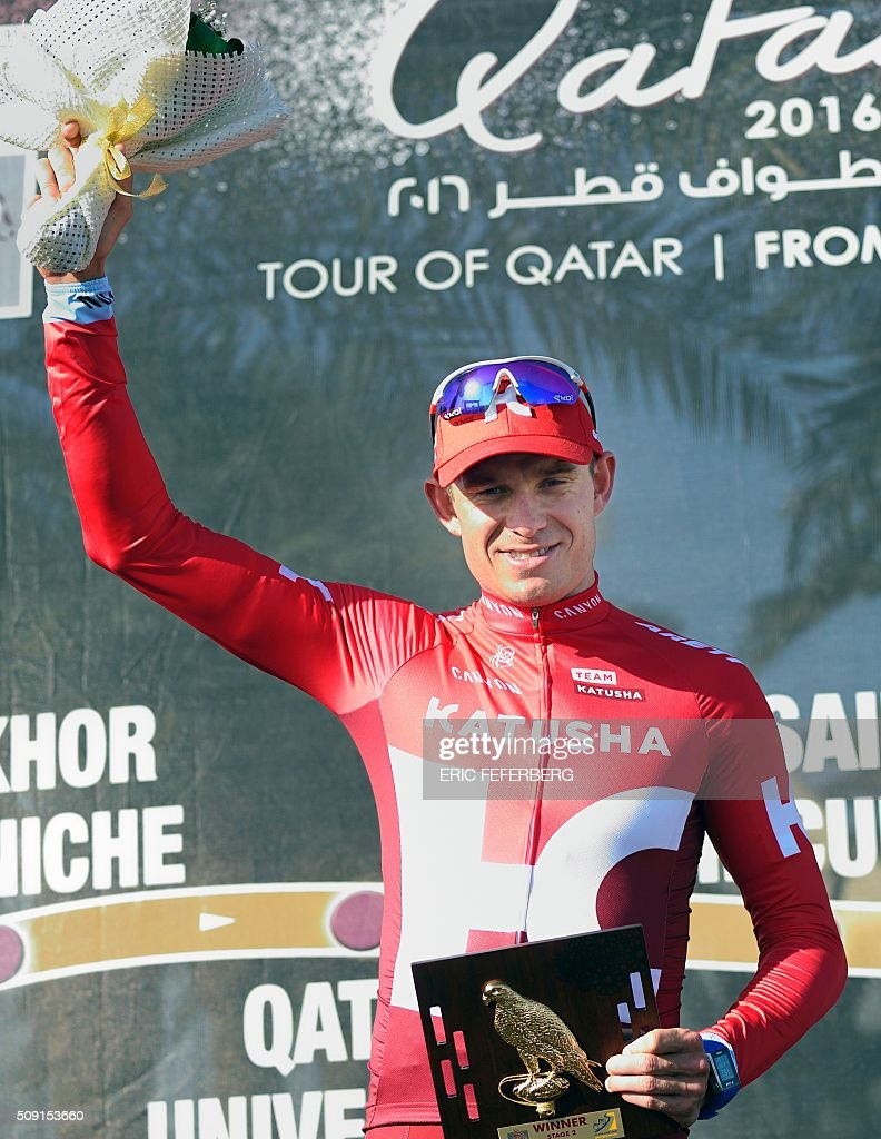 Katusha team leader Norvegian Alexander Kristoff celebrates on the podium after winning the second stage of the 2016 Tour of Qatar, a 135 kilometres circuit starting and finishing at the Qatar University, on February 9, 2016. Kristoff won a sprint finish ahead of Britain's Marc Cavendish for the second stage of the Tour of Qatar. FEFERBERG