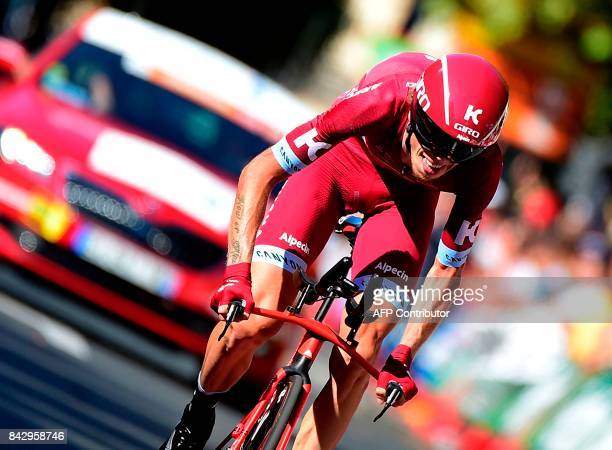 TOPSHOT KatushaAlpecin's Rusian cyclist Ilnur Zakarin sprints before crossing the finish line of the 16th stage of the 72nd edition of 'La Vuelta'...
