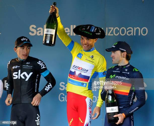 Katusha's Spanish rider Joaquim Rodriguez celebrates his victory with Sky's Colombian rider Sergio Henao and Movistar's Spanish rider Ion Izagirre on...