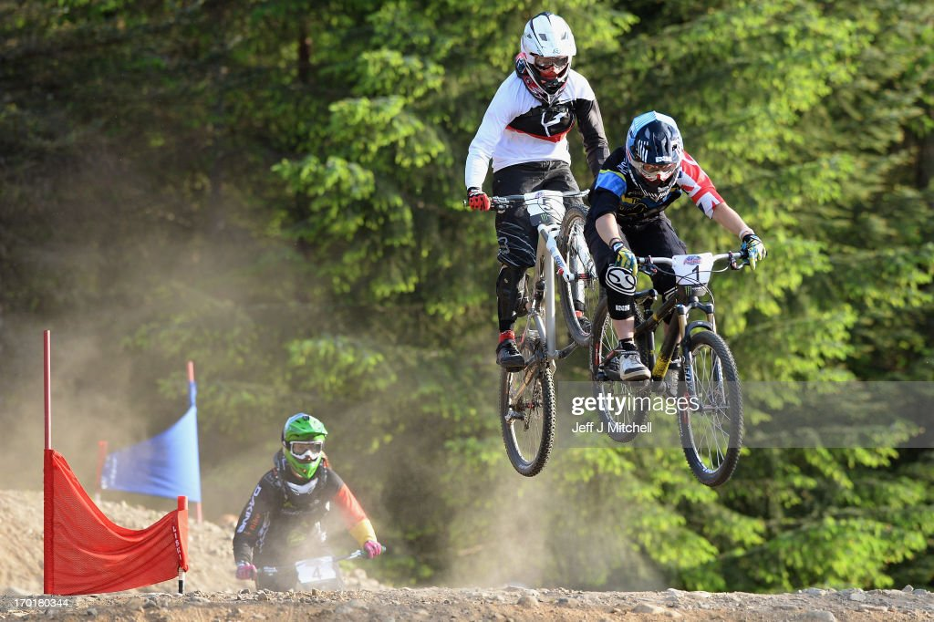 Katy Curd and Licia Oetjen competes in the women's four cross pro tour qualification at the UCI Mountain Bike World Cup on June 8, 2013 in Fort William, Scotland.