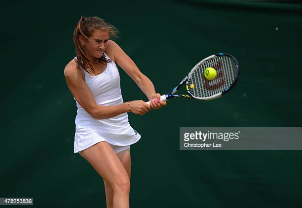 Katy Dunne of Great Britain in action against Richel Hogenkamp of Netherland in the Ladies Second Round match during the 2015 Wimbledon Qualifying...