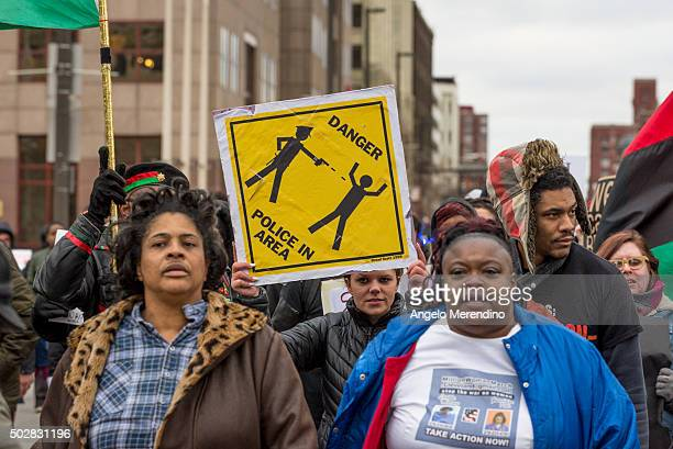 Katy Kostenko a 19year old resident of Cleveland marches with other activists on St Clair Ave on December 29 2015 in Cleveland Ohio Protestors took...