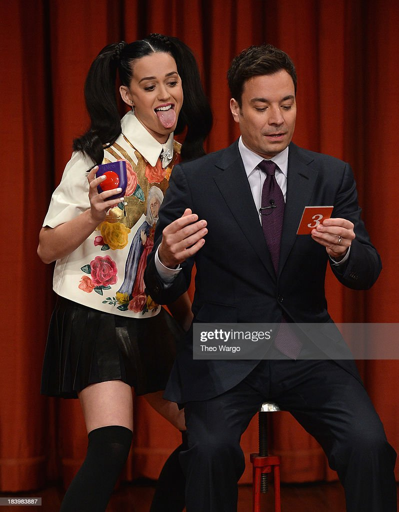 Katy Perry and Jimmy Fallon play a game of Taboo during a taping of 'Late Night With Jimmy Fallon' at Rockefeller Center on October 10, 2013 in New York City.